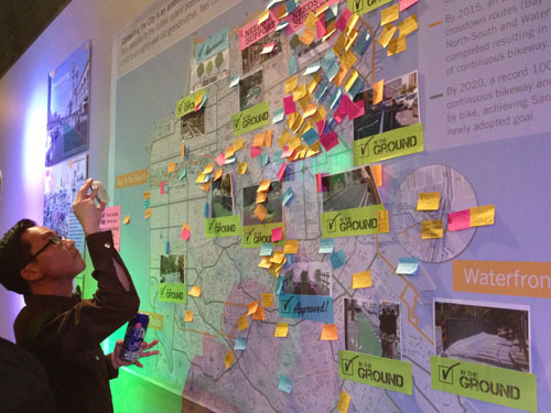 A large city map was posted on a wall and comments about what bike lanes are wanted were solicited by sharpies and post-its.