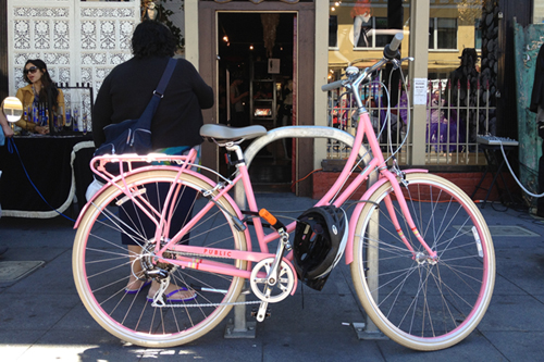 I think she needs a pink helmet as well (PUBLIC dutch-style bike).