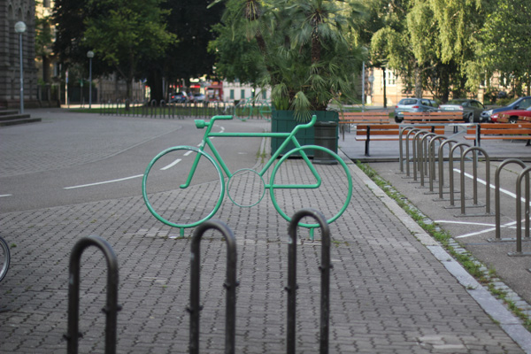 Bicycle racks are placed ideally next to a cycle track.