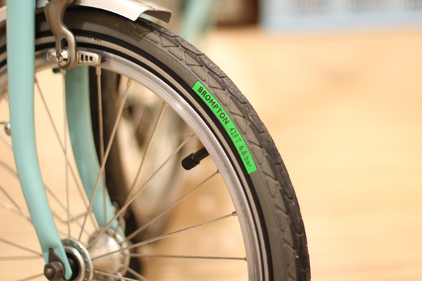 Standard tires that comes with Kevlar belts to resist punctures and good treads to grip slippery road surface.
