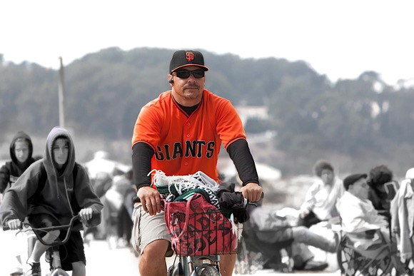 SF Giants fan on a bicycle. (Image courtesy of inmenlo.com)