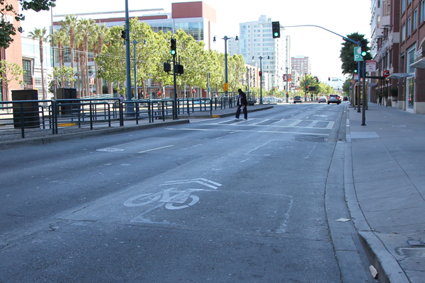 Bike sharrow is placed in the middle and the original sharrow near the gutter is gone.