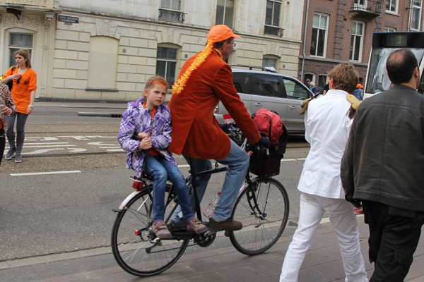 Here is this girl and her father dressed for Queen's Day.