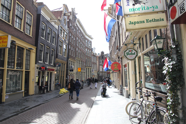 narrow sidewalks force pedestrians to walk on streets