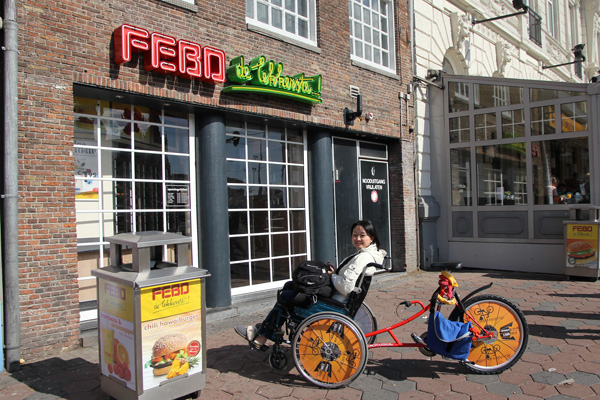 Nellie on a wheel-chair bike at FEBO
