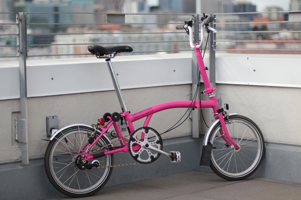 Nellie's hot pink Brompton.