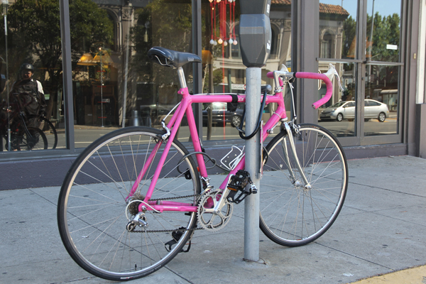 A beautiful pink Cannondale aluminum road bike.