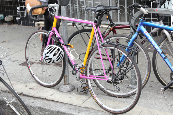 Pink and yellow Centurion steel frame road bike.