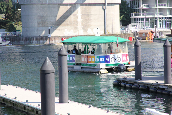 An Aquabus ferry that accepts bicycles. Look for that big bicycle sign.