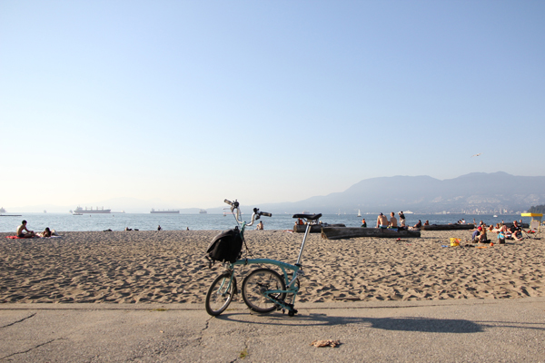 My Brompton is sunbathing on Kitsilano Beach.