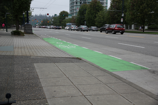 Green paint to alert drivers crossing bike lane.