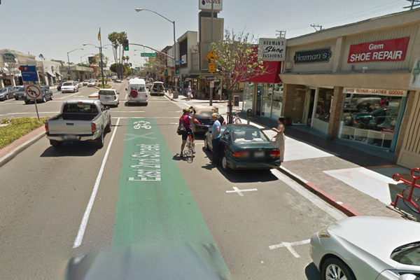 2nd St. commercial corridor in Long Beach, CA. Notice numerous shops and traffic lights.
