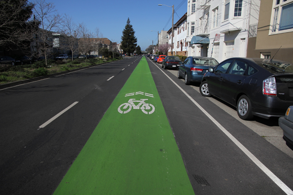 Green sharrow bike path on 40th St. in Oakland, CA.