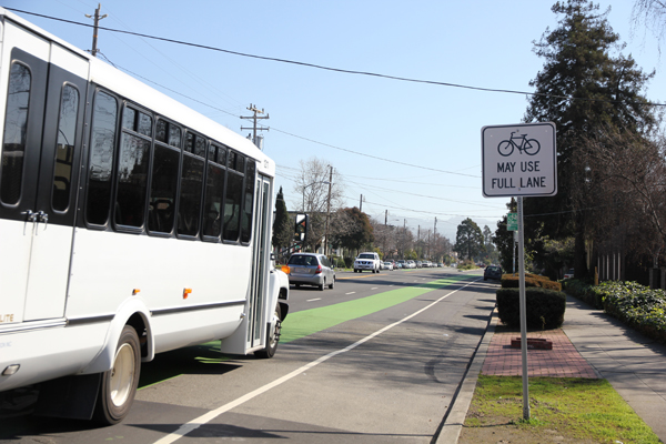 Note the lack of traffic lights and long distance before each intersection suggests bikes and cars shouldn't be mixed.