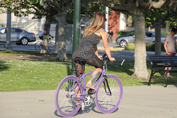Tattoos and a purple bike, reminds of those easter eggs.