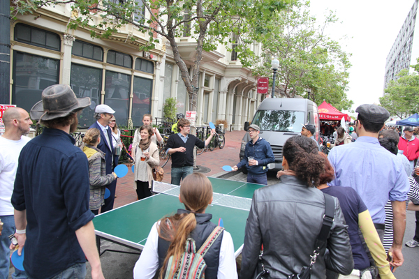 Too many people want to play ping pong, so everyone got a paddle and get to hit the ball one at a time.  LOL!