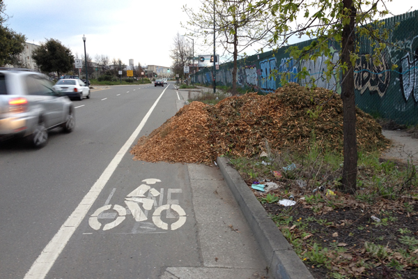 What is this? Cattle food in the middle of a bike lane? Why does the city allow this?