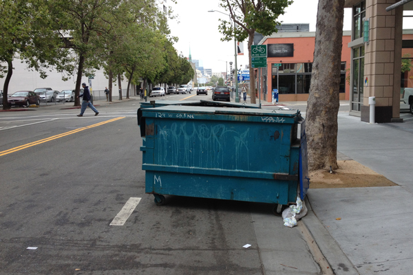 Pathetic! Bike lane is blocked by two trash bins. That is how bicyclists are treated.