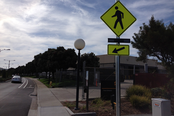 A few of these pedestrian signals are installed.  You have to press a button to cross.