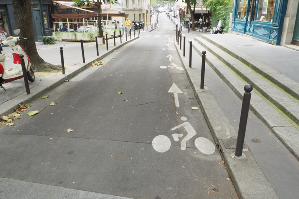 Many narrow one-way streets have contra-flow bike lanes.