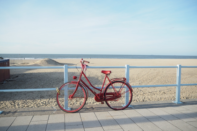 A beautiful red bike at Scheveningen beach.