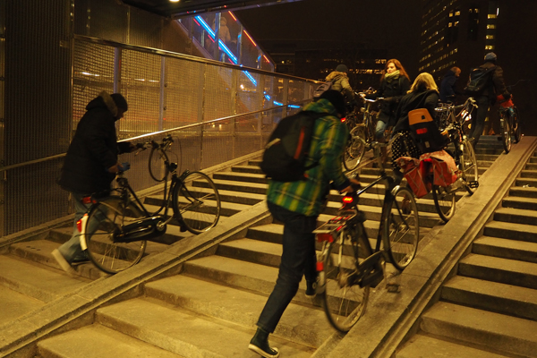 Bike ramps at a bike parking garage in Utrecht. Note the easiness of pushing bikes up and down the stairs.
