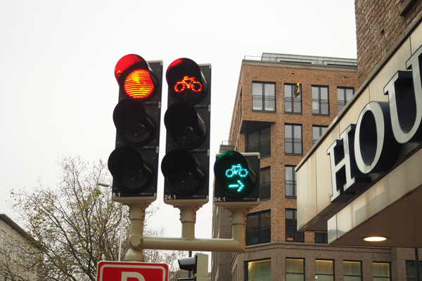 Traffic lights for cyclists at a junction in Utrecht. Cars are not allowed to turn right on red.