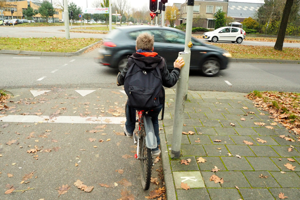 A boy biking home alone from school in Apeldoorn.