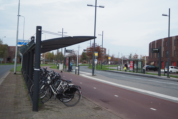 A bus stop with bike racks in Eindhoven.