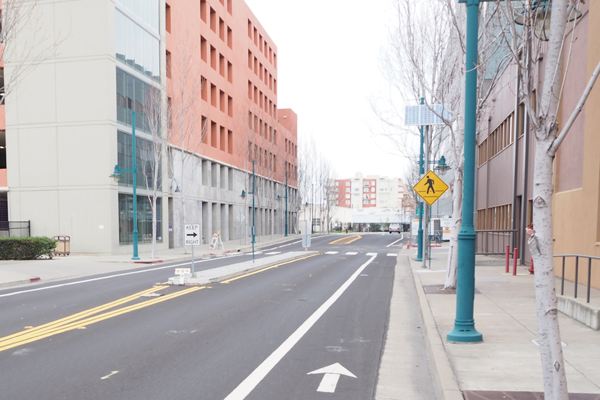 A middle divider to calm traffic on Horton St. where major companies are located.